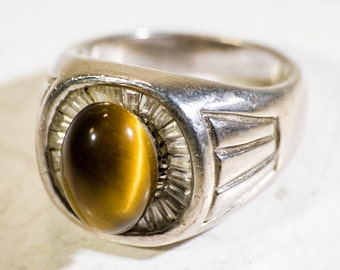 Large vintage sterling silver gent's ring with tiger eye cabochon and diamante on a wide band.