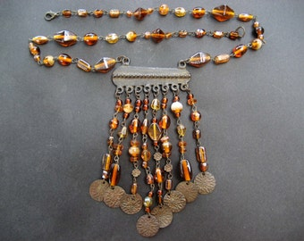 An antique amber glass necklace from Afghanistan or Pakistan circa 1970's  ..... AP66