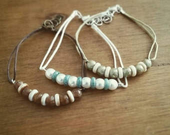 Beaded string bracelet in different colors