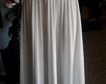 Vintage 1970s pleated maxi skirt, in pleated metallic silver polyester.