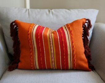 Handwoven wool pillow cover with fringe orange red brown with raised woven texture handmade textile