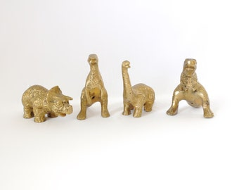 Vintage set of brass dinosaurs