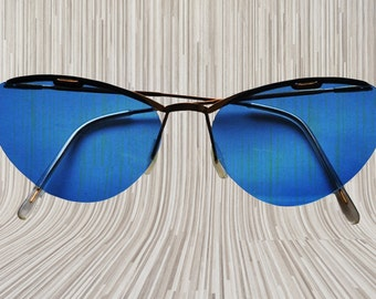 SALE Authentic vintage midcentury cateye sunglasses with a small golden frame and early plastic blue lenses. Rock& Roll style SALE
