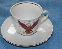 E & R 1866 Golden Crown made in Germany Tea Cup and Saucer w Bald Eagle Design