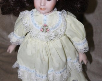 Vintage Porcelain, Doll, Head, Curly Brown Hair, Cotton body, Lace Edging, Puffy Arms, Bloomer Underwear, With Metal Doll Stand, Collectible