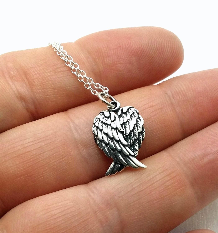 sterling angel wings necklace folded wings griever. Black Bedroom Furniture Sets. Home Design Ideas