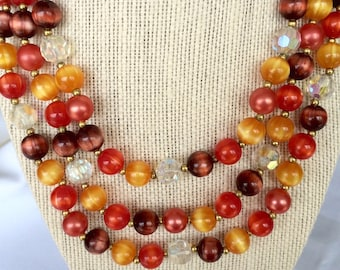Vintage Lisner Necklace in great colors. Three strands with Red, Amber & brown beads.  Signed Necklace has definite 1950's-1960's styling
