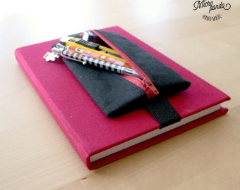 Pen case with elastic band for notebooks, made with black jeans