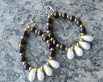 Earrings with purple and white gold beads