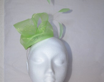 Pale green fascinator with loops and feathers. Handmade.