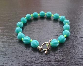 Neon yellow threaded opaque aqua czech glass beaded bracelet