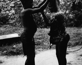 Water games during a chill in the rainy season in the Dogon Country, Mali 1996