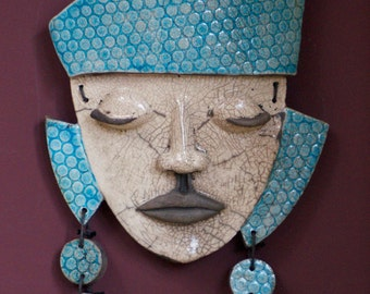 Mask with headdress and earrings