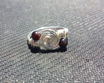 WIRE WRAPPED RING Garnet Twist Ring in Silver Handmade