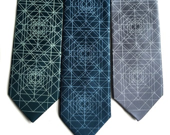 Op Art Geometric Print necktie. Converging triangles silkscreened silk tie. Psychedelic optical illusion. Your choice of colors & width.