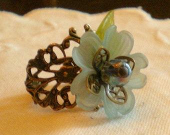 oO FLORA Oo aqua flower brass ring