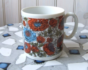 vintage small mug with blue and rust flower design
