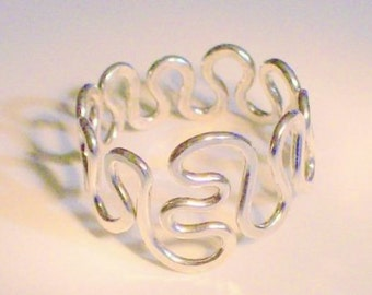 sterling silver squiggle ring-size  5-1/2 to 11