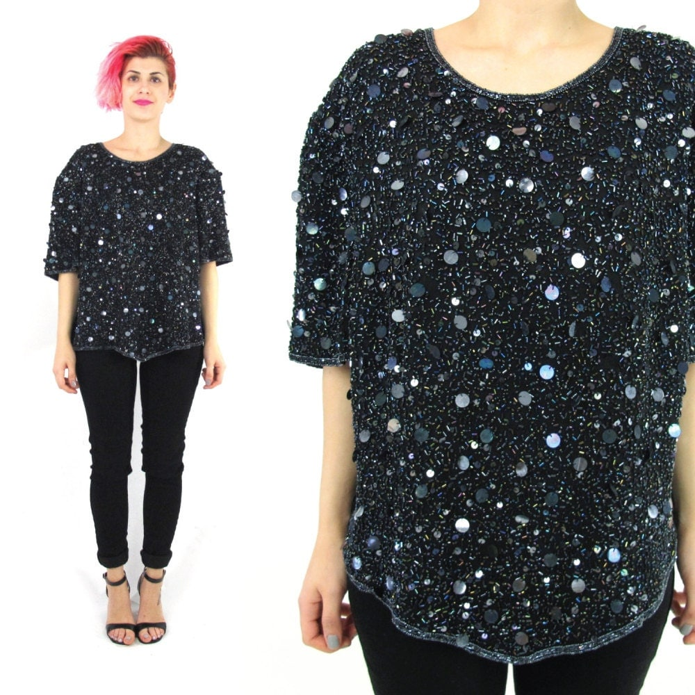 Sequin Tops. There's something about sequins that is an instant mood booster. Maybe it's the way they glitter in the light, or the playful image they give to everything you're wearing.
