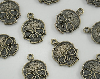 10 pcs Zinc Antique Brass Skull Coin Vintage Charms Jewelry Decorations 20x14 mm. SK BR 2014 204