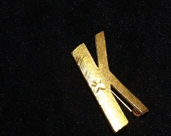 "Mamselle pin - the Letter ""K"" Signature pin"