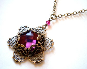 Layered filigree pendant necklace - purple rhinestone wrapped in filigree on brass chain. Antique gold, ruby crystal accents, plum jewelry