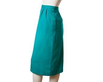 Vintage teal blue pencil skirt with pockets -- knee length midi skirt -- size medium