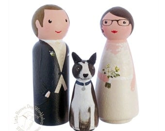Bride, groom and pet dog wooden peg doll wedding cake topper. Personalised hand painted keepsake, peg people and wood doll decorations
