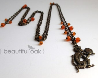 peachy monkey layered necklace