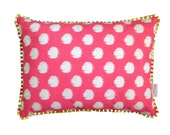 SALE: Coral pink Ikat spot lumbar cushion with yellow tassel trim