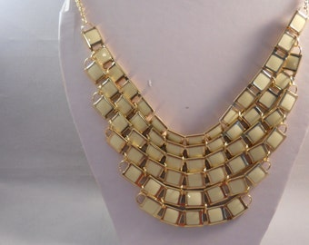 6 Row Gold Tone Bib Necklace with off White Tile Beads on a Gold Tone Frame
