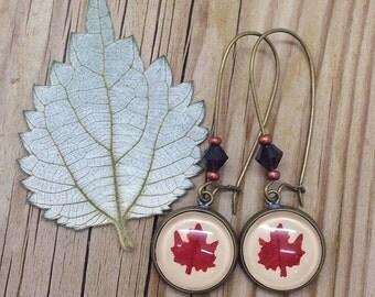 maple earrings - leaf earrings -unique jewelry - cute Earring leaf maple shape cut out over beig leather - botanical earring - MissMayoShop