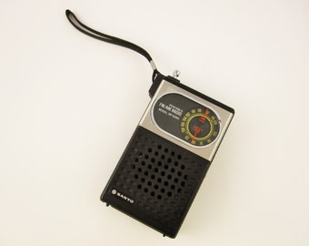 A Vintage 1970s Sanyo Portable Radio - Model RP5050 - Made in Singapore - Antennae and Wrist Strap - Earphone Plug - Fm/AM