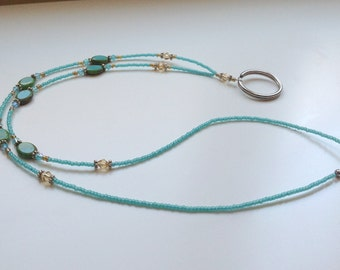 Delightfully delicate teal and amber beaded badge lanyard