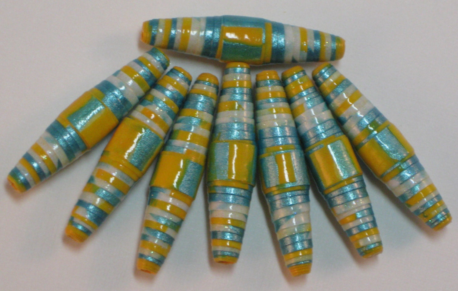 recycled paper beads Handmade recycled plastic and paper beads from africa.