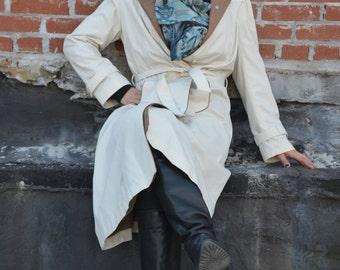 tan raincoat with tie belt