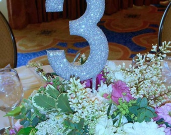 Glitter table numbers on wooden stick for weddings and events