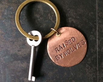 Raised by Wolves stamped copper keychain, pendant or clip for backpack, snarky gift, gifts under 20