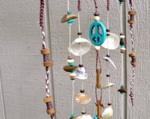 Outdoor mobile/wind chime with natural seashells, genuine turquoise, peace sign and hemp