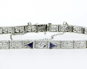 Platinum and 14K Gold Bracelet with Diamond and Sapphires