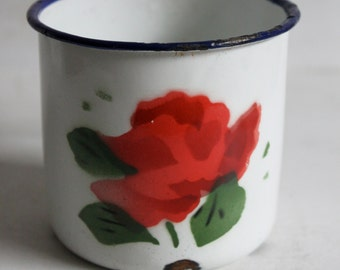 Set of two white enamel mugs with red flowers.