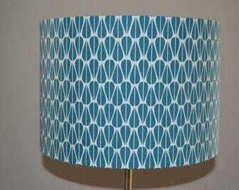 Handmade lampshade using repeated symmetrical Scandinavian inspired teal leaf pattern