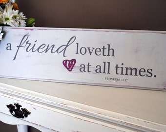 A friend loves at all times - A friend loveth at all times. Perfect distressed, wood sign for your friends! Proverbs 17:17
