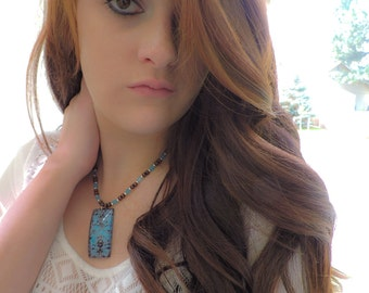 Blue and brown wallpaper necklace