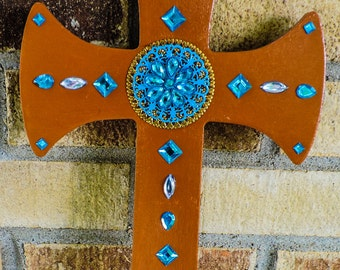 Bright blue and brown jeweled cross