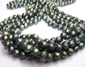 Faceted Green Freshwater Pearls 6-7mm 15.5 inch strand