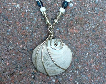 Coastal jewelry sterling silver natural clam shell necklace.