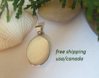 Mother of pearl pendant set in 92.5 sterling silver