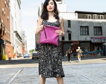 The classic  leather fold clutch in deep orchid