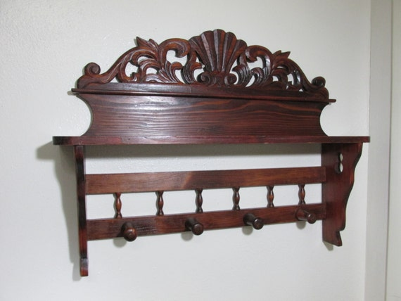 Hanging carved shelf with pegs for Picture hanging pegs